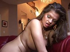 A Well Fed Brunette Making The Best Use Of A Black Cum Tool