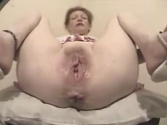 Old Hoebag Shows Off Her Enormously Huge Wet Pussy