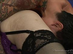 Mummy does her brunette inked gf with strap dildo