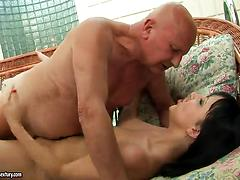 Yummy brunette babe fucked by an old dude near a pool